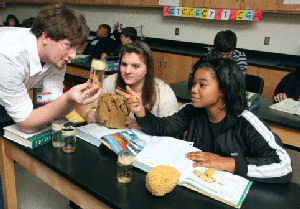 Science Teacher teaching multi-racial students